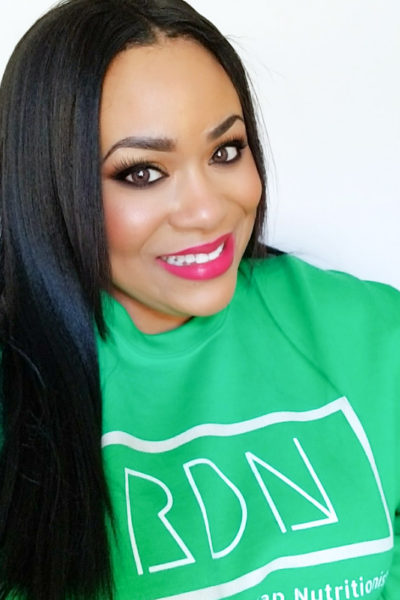African American Registered Dietitian Nutritionist in a green sweatshirt with RDN on the front, for Happy Registered Dietitian (RDN) Day