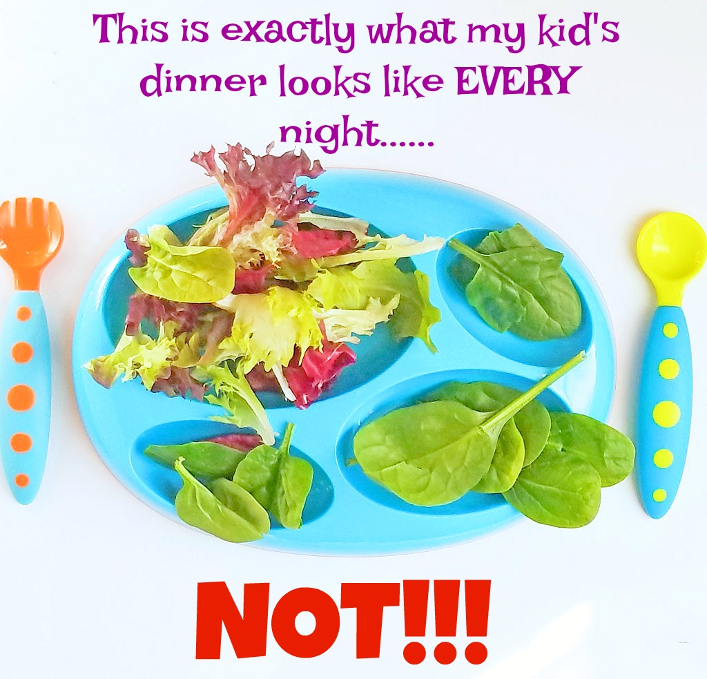 blue toddler plate of spinach and spring salad mix