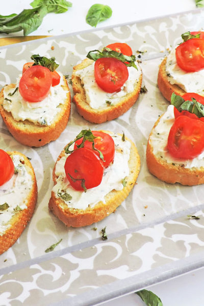 Herb Cream Cheese and Tomato Crostini- toasted baguette slices topped with basil herb cream cheese and sliced grape tomatoes