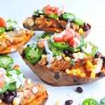 Loaded Spicy Southwest Chicken Sweet Potatoes topped with diced tomatoes, corn, black beans, jalapenos, and sour cream. Alka Seltzer PM Gummies