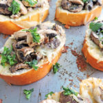 Cheesy Herb Mushroom Garlic Toast-toasted french bread topped with Land O Lakes Soft Squeeze Spread, mozzarella, mushrooms, garlic, and herbs.