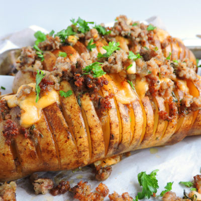 Spicy Smoked Gouda & Sausage Hasselback Potatoes made with Odom's Tennessee Pride Mild Sausage, topped with rosemary and parsley beautifuleatsandthings.com