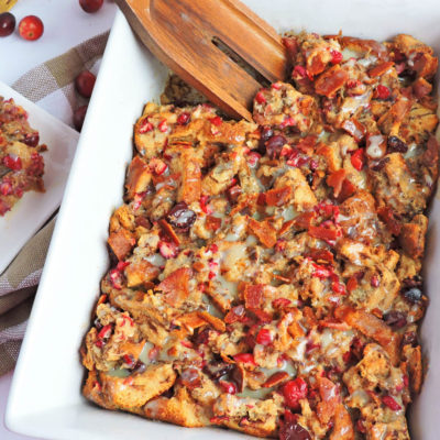 Maple Bacon Cranberry French Toast Casserole made with La Lechera and in a casserole dish with cranberries and bacon on top